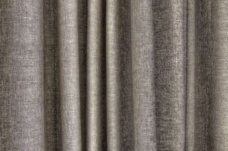 closeup detail of taupe color curtain texture