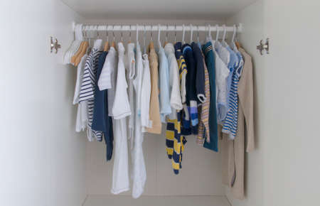 open kids male wardrobe collection in closet