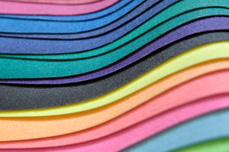 image cluseup detail of multicolored fabric cloth stack