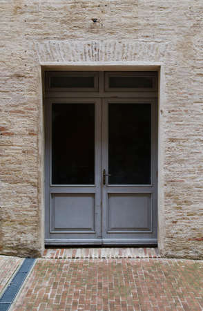 old brick house with light gray door detail