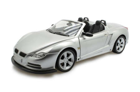 car wheels: isolated toy convertible sports car on white