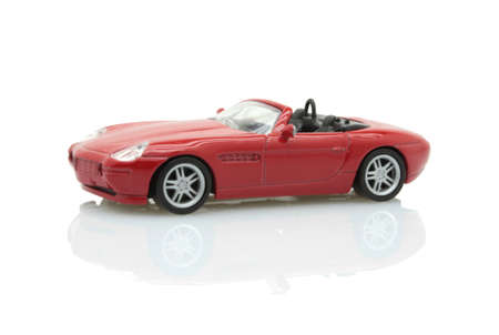 isolated red toy sports car with reflection Stock Photo