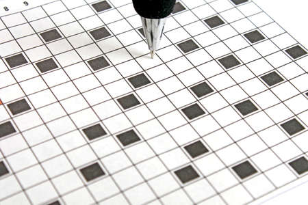 closeup of blank crossword with focus on the ballpen Stock Photo