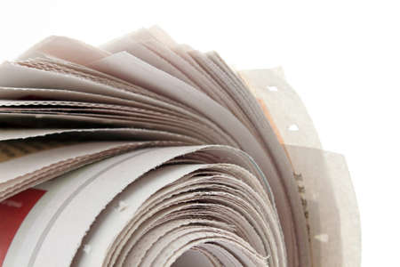 closeup of newspaper roll on white