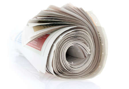 closeup of a newspaper roll on white Stock Photo - 8920834