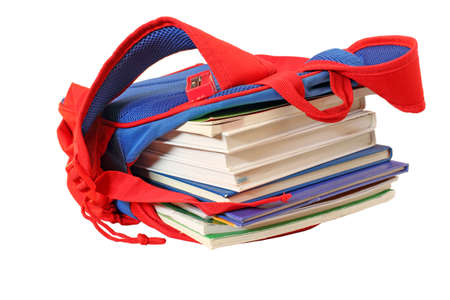 isolated school bag with books on white Imagens
