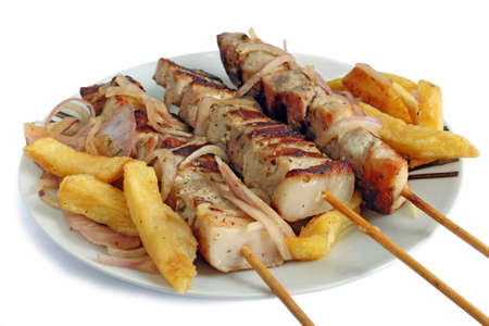 taverns: dish with souvlaki with onion and french fries Stock Photo