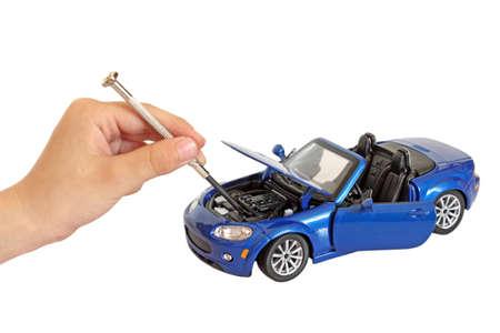 boy repairing a toy  car