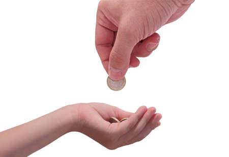 pocket money: adult giving a euro coin to a child