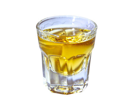 full shot: shot glass with whisky isolated