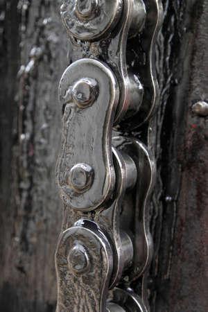stagnate: greasy chain closeup