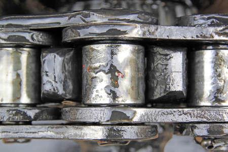 greasy chain on cogwheel