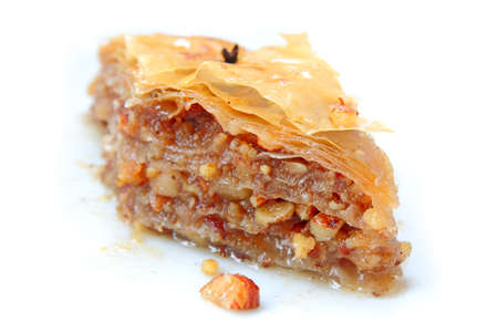filo pastry: piece of baklava on white