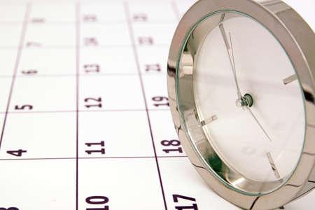 chrome clock rolling on calendar photo