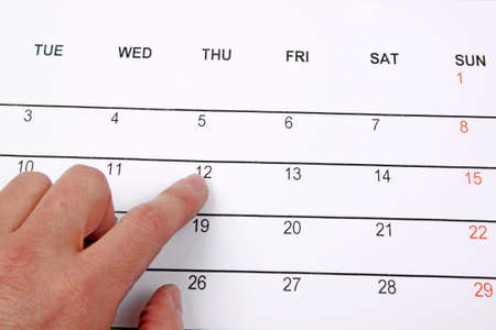 hand pointing on calendar  Stock Photo - 13124000