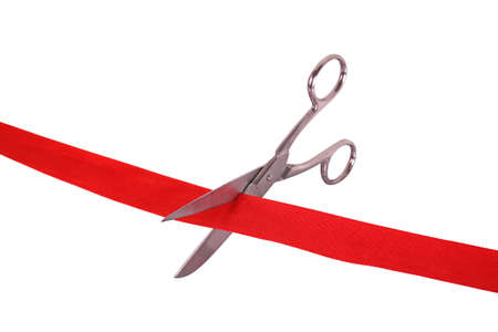 ribbon cutting: scissors cutting a red ribbon Stock Photo