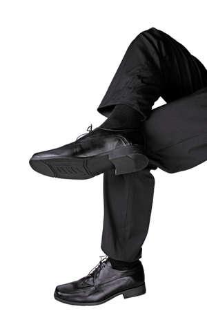 cross leg: businessman sitting crosslegged  Stock Photo