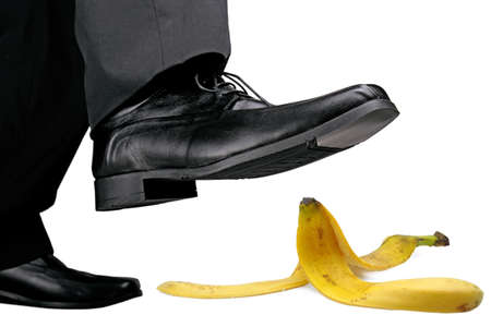 banana skin: businessman about to step on banana peel