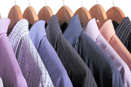 formal shirt: variety of shirts on wooden hangers Stock Photo