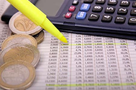 investment risk: highlighting stock market figures on newspaper