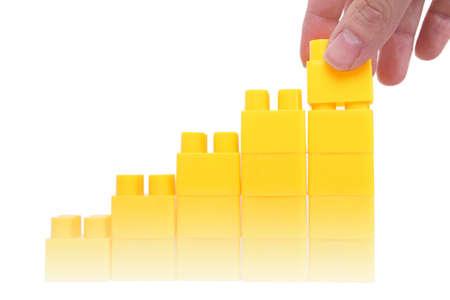 hand adding a block on graph column photo