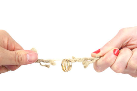 tug: tug of war between husband and wife  Stock Photo