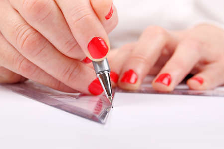 woman is drawing on blank paper photo