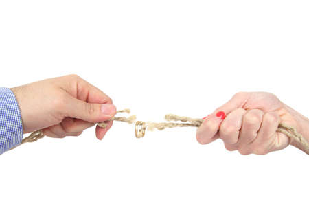 separate: tug of war between husband and wife Stock Photo