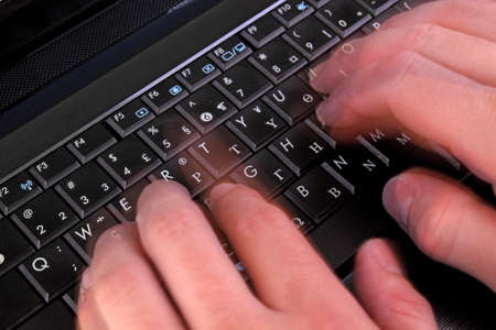 typing on laptop keyboard Stock Photo - 13993254