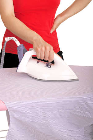 bored woman is ironing a shirt photo