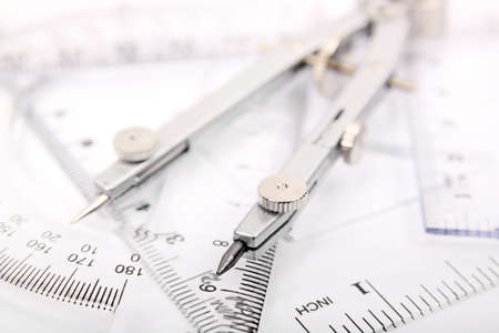 shallow dof of compass on rulers photo