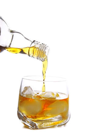whisky being poured into glass full of ice cubes Stock Photo - 14544641