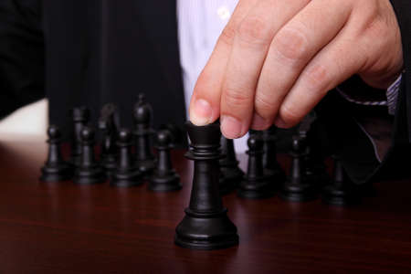 concept with businessman playing chess  Stock Photo - 14598314