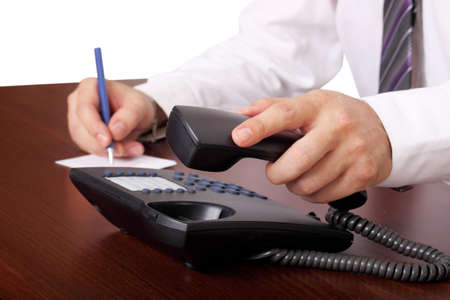 calling communication: man is answering or hanging up the phone in an office Stock Photo
