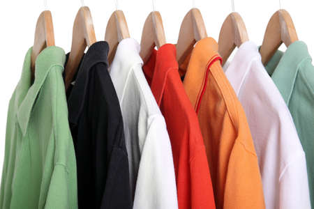 seasonal clothes: colorful polo shirts on hangers