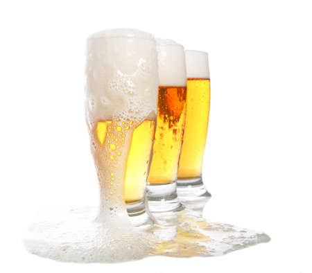 three glasses of beer on white Stock Photo - 14970543