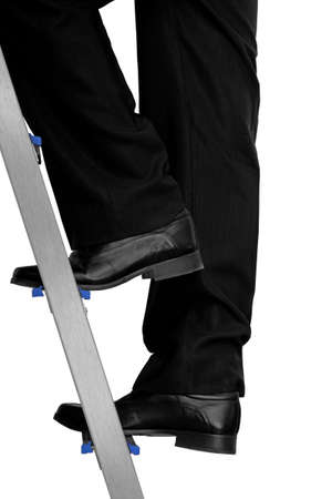 prospect: formally dressed man going up a ladder Stock Photo