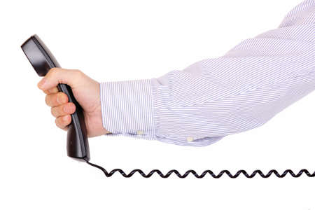 man is handing over a telephone receiver  photo