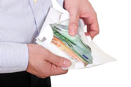 man checking out envelope with cash