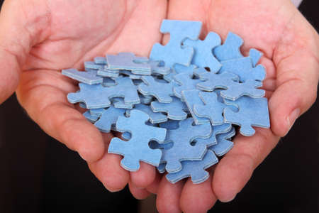 ability: jigsaw puzzle pieces in mans palms