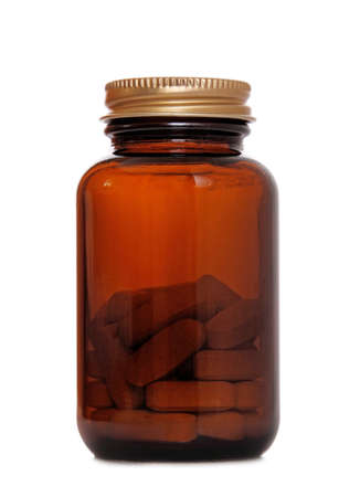 pills bottle: transparent brown bottle with pills on white Stock Photo