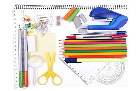 variety of school items on notebook Stock Photo - 15982526
