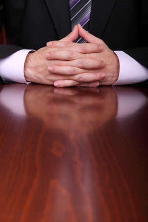 dread: formally dressed man behind luxurious desk Stock Photo