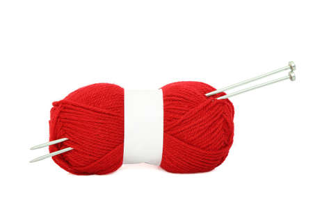 knitting needles and  yarn ball on white