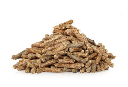 heap of wood pellets on white photo