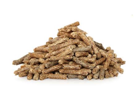 bioenergy: heap of wood pellets on white