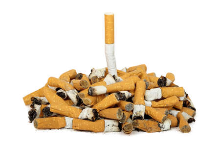 disgusting: quit smoking concept with whole cigarette among cigarette butts