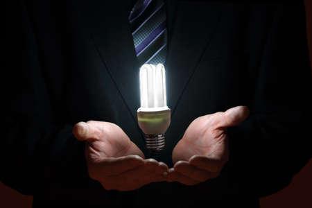 lit lamp: suspending lit lamp in businessmans palms