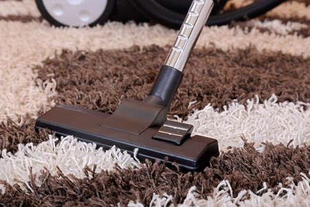 vacuum cleaner on fluffy carpet Imagens