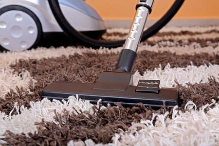 dirty carpet: vacuum cleaner on fluffy carpet Stock Photo